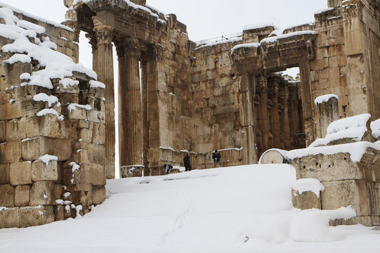 Residents enjoy snow at the ruins of the Roman Temples of Bacchus at the historical ruins of Baalbek in eastern Lebanon