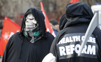 An activist wears a skull mask during a protest in support of Russian doctors and patients against reforms to the healthcare system in Moscow