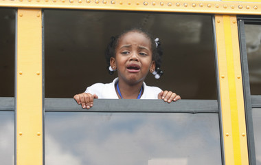 Aaliya Battle cries for her mother as she waits on a school bus after she was bused to a local Walmart following an shooting incident at McNair Discovery Learning Academy in Decatur