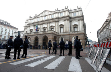 Carabinieri officers stand outside La Scala opera house before the opening of the 2016-17 opera season with Puccini's Madama Butterfly in Milan