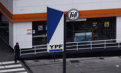 A man walks inside a YPF gas station in Buenos Aires