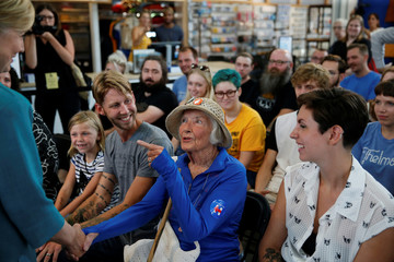 A woman speaks with U.S. Democratic presidential nominee Hillary Clinton while visiting Raygun, a clothing store, in Des Moines