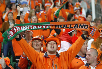 Netherlands' supporters cheer their team during their Euro 2012 qualifying Group E soccer match against Hungary at Budapest's Puskas stadium