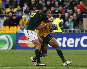 South Africa Springboks' Morne Steyn tackles Australia Wallabies' Digby Ioane during their Rugby World Cup quarter-final match at Wellington Regional Stadium