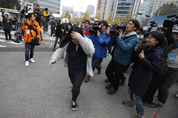 A student who is late for the annual college entrance examinations rushes to the exam hall in Seoul