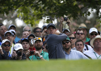 Rory McIlroy of Northern Ireland watches his tee shot off the fourth hole during his practice round ahead of the 2015 Masters at the Augusta National Golf Course in Augusta