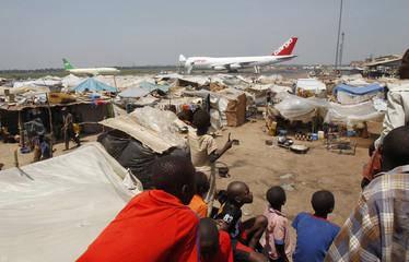 WFP humanitarian plane unloads sacks of cereal at Mpoko international airport in Bangui