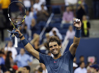 Rafael Nadal of Spain celebrates defeating compatriot Tommy Robredo during their men's quarter-final match at the U.S. Open tennis championships in New York