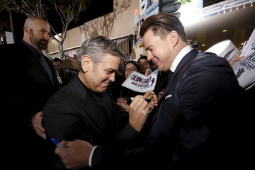 "Cast members Clooney and Tatum pretend to autograph each other at the premiere of ""Hail, Caesar!"" in Los Angeles"