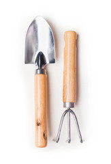 Gardening tools on white background, top view