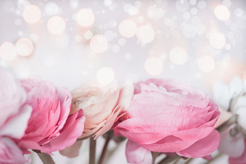 Close up of Beautiful pastel flowers with bokeh light. Festive greeting card. Floral border.