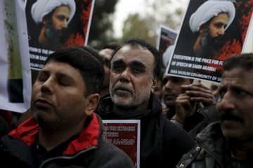 A Shi'ite Muslim cries during a demonstration against the execution of Shi'ite cleric Sheikh Nimr al-Nimr in Saudi Arabia, outside the embassy of Saudi Arabia in Athens