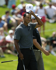 Tiger Woods walks off the green on the 18th hole during the Memorial Skins Game at Muirfield Village Golf Club in Dublin