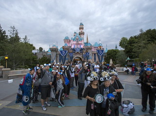 People pose for photos during Disneyland's Diamond Celebration in Anaheim