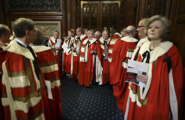 Members of The House of Lords wait in the Prince's Chamber for Queen Elizabeth and the State Opening of Parliament in London