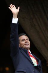 Mexico's President Enrique Pena Nieto salutes during a military parade celebrating Independence Day at Zocalo Square in downtown Mexico City