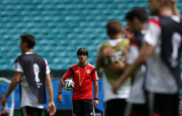 Germany's coach Loew watches his players during a training session at the Arena Fonte Nova stadium ahead of their 2014 World Cup against Portugal in Salvador