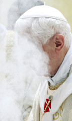 Pope Benedict XVI burns incense as he celebrates a mass during his pastoral visit to St. Corbiniano Parish in Rome
