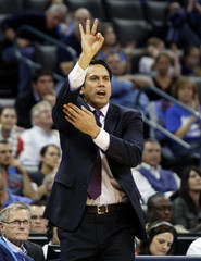 Heat head coach Spoelstra shouts a play to his team  against the Thunder in the second half of their NBA basketball game in Oklahoma City.