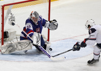 Ryan of the U.S. tries to score past Slovakia's goalkeeper Laco during their 2012 IIHF men's ice hockey World Championship game in Helsinki