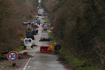 Obstacles and shelters partially block a road in Notre-Dame-des-Landes
