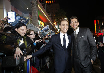 "Cast members Hiddleston and Levi pose at the premiere of ""Thor: The Dark World"" at El Capitan theatre in Hollywood, California"