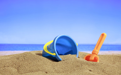 Summer vacations - Bucket on a sandy beach
