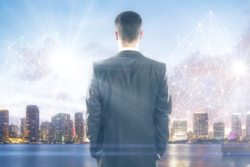 Man looking at city with polygonal pattern