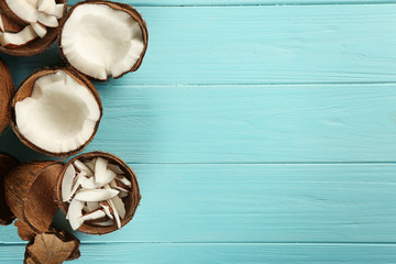 Beautiful composition with fresh coconuts on wooden background