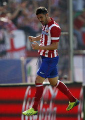 Atletico Madrid's David Villa celebrates his goal during their Spanish first division soccer match against Almeria in Madrid