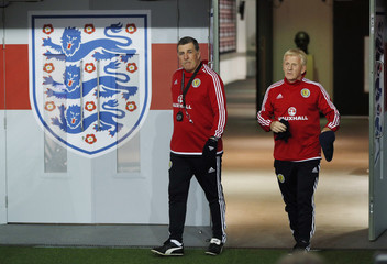 Scotland manager Gordon Strachan arrives for training with assistant manager Mark McGhee