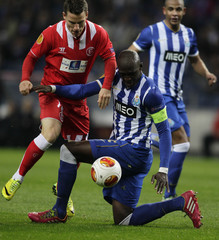 Porto's Mangala battles for the ball with Sevilla's Gameiro during their Europa League quarter-final first leg soccer match at the Dragao stadium in Porto