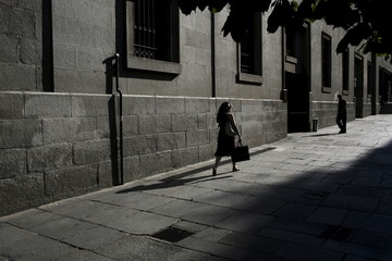 A woman walks outside Teatro Real in Madrid