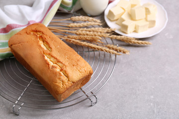 Baked butter cake with ingredients on table
