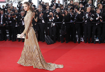 Model Palvin arrives on the red carpet for the screening of the film Lawless at the 65th Cannes Film Festival