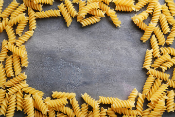 Spiral pasta on the grey wooden table