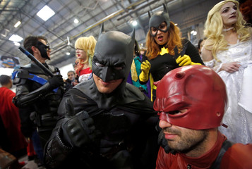 Participants wearing fantasy and superhero costumes pose for a picture during the Hero Festival in Marseille, France
