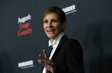 """Roberts waves at the premiere of """"August: Osage County"""" in Los Angeles"""