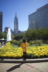 A woman visiting from Houston, Texas, poses for a photo in Love Park, in Philadelphia, Pennsylvania