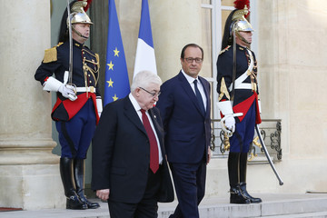 French President Francois Hollande walks with Iraq's President Fuad Masum after a meeting at the Elysee Palace in Paris