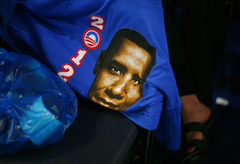 A tee shirt with a picture of Obama is seen on a chair during the final session of the Democratic National Convention in Charlotte