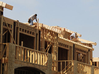 Construction workers are shown on a residential housing work site in Burbank