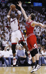 Heat's Bosh shoots over Bulls' Asik during Game 3 of their Eastern Conference Finals NBA basketball series in Miami