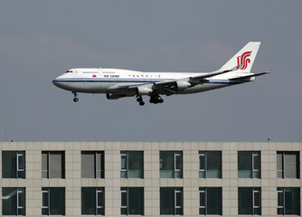 An Air China Boeing 747 passenger jet lands at the Beijing Capital Airport