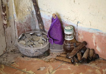 Elements used in Santeria rituals by Cuban spiritualist, fortune teller and witch Mayra are seen in a corner of her home in Havana
