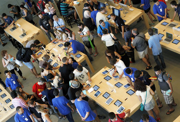 Employees and customers at the official opening of the largest Apple shop in southern Europe, at Passeig de Gracia in Barcelona