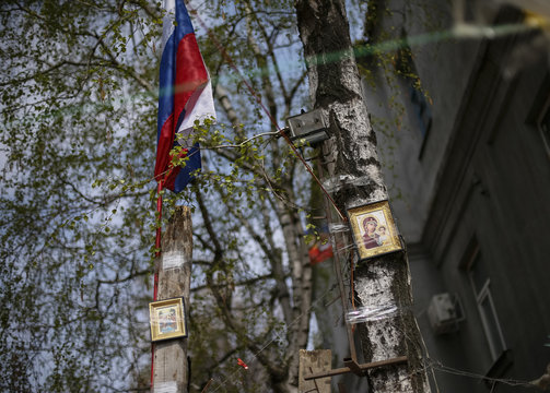 Orthodox icons and a Russian flag are seen over barricades at the police headquarters in the eastern Ukrainian town of Slaviansk