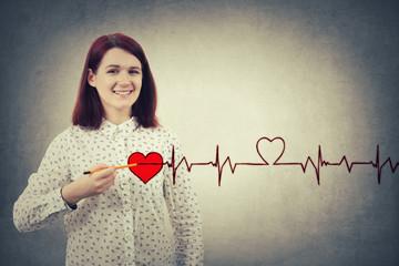 woman drawing heartbeat