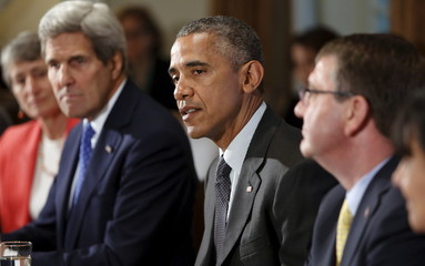 Obama, flanked by Jewell, Kerry and Carter, holds a cabinet meeting at the White House