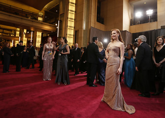 """Chastain, best actress nominee for her role in """"Zero Dark Thirty,"""" poses wearing a copper Armani Prive gown at the 85th Academy Awards in Hollywood"""